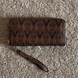 Brown leather wristlet wallet with boho design